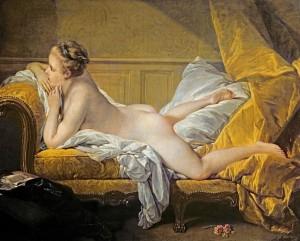 ソファーに横たわる裸婦