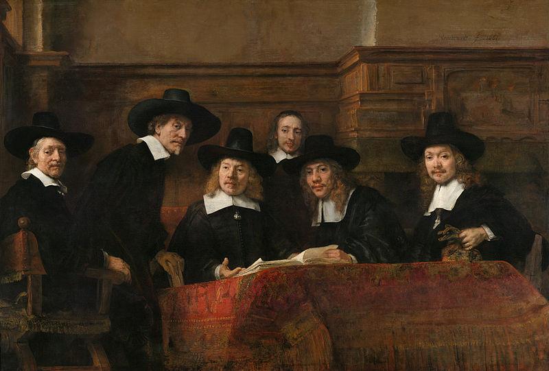 800px-Rembrandt_-_De_Staalmeesters-_het_college_van_staalmeesters_(waardijns)_van_het_Amsterdamse_lakenbereidersgilde_-_Google_Art_Project