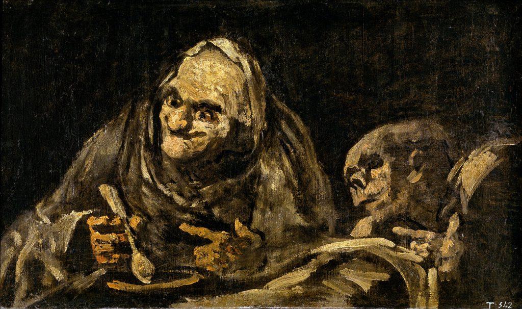 スープを飲む老人