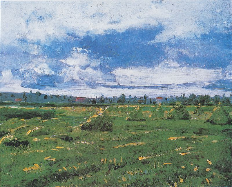 干し草の山のある麦畑