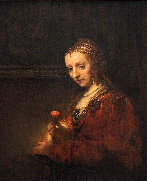 ピンクのカーネーションを持つ女性の肖像