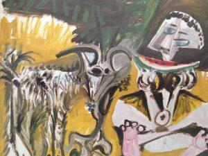 すいかを食べる男と山羊