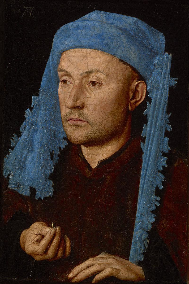 青い帽子の男