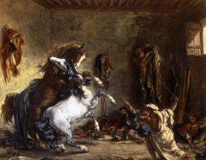 厩で喧嘩するアラブの馬