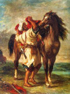 馬に鞍を乗せるアラブ人