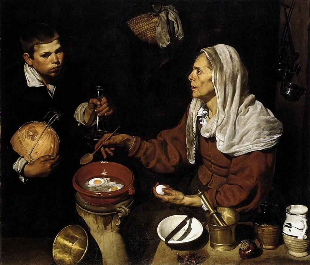 卵を調理する婆