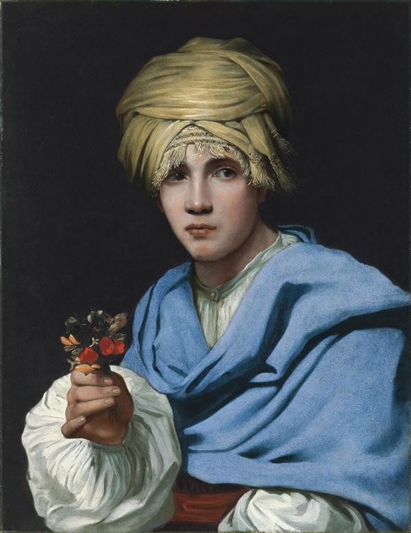 小さな花束を握ったターバンを被った少年