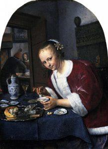 牡蠣を食べる少女