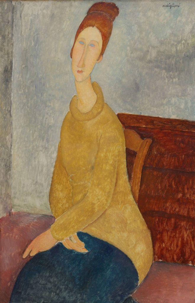 黄色いセーターを着たジャンヌ・エビュテルヌ