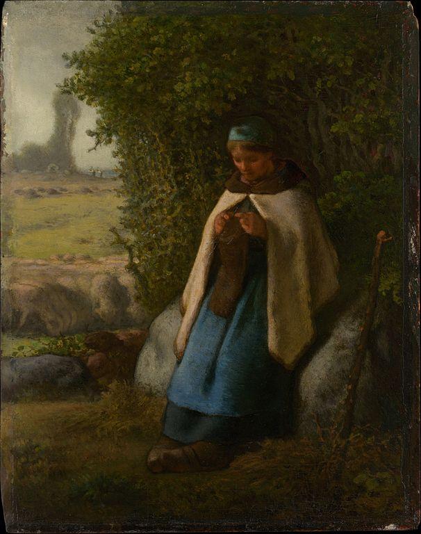 岩の上に座る羊飼い