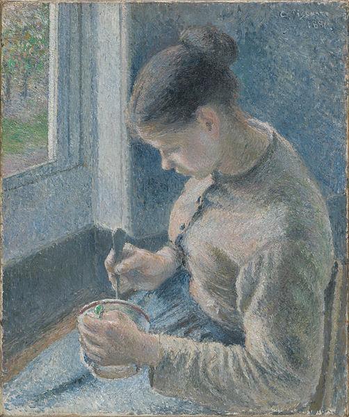コーヒーを飲む若い農婦