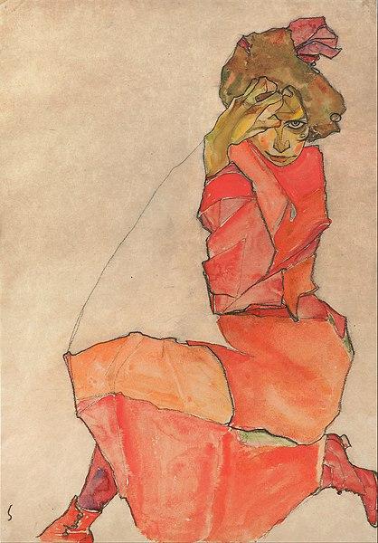オレンジのドレスでひざまずく女