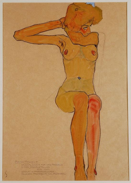 裸で座る女