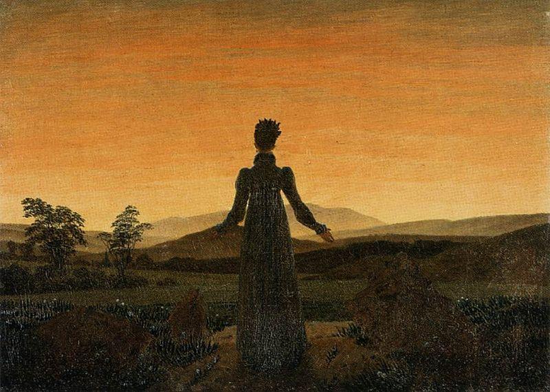 日の出の前の女性