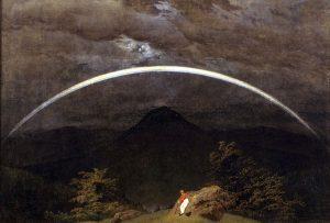 虹のかかる山岳風景