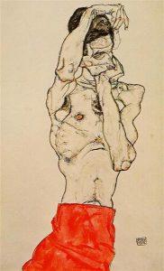 赤い腰巻で立つ裸の男