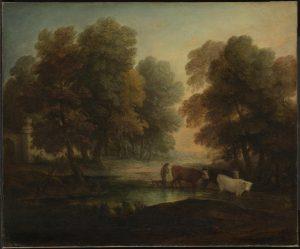牛を池に導く少年