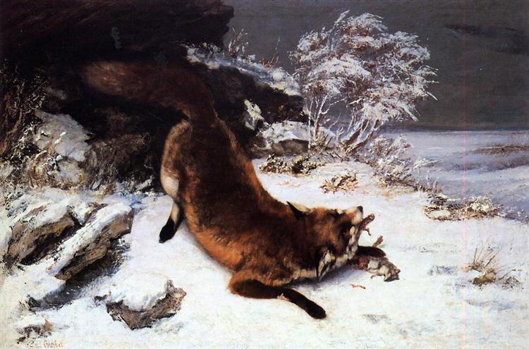 雪の中の狐