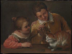 猫をからかう二人の子供たち