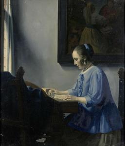 楽譜を読む女