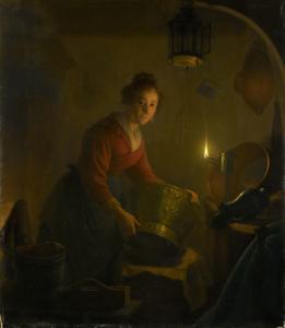 キャンドルライトで照らされた台所にいる女