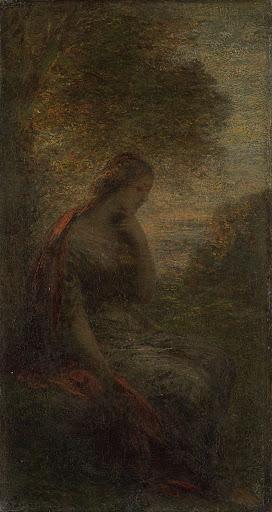 秋、日没の木の下の女