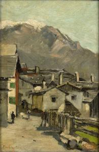 山の近くにある道沿いの家々