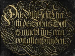 「神の息子、イエス・キリストの血は我々をすべての罪から浄化する」と書かれた、ガラスの後ろからのカリグラフィーの絵