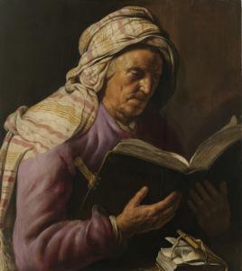 読書している年老いた女