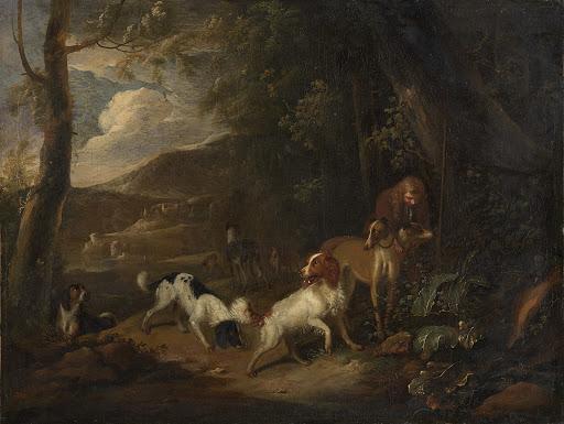 森の隅で猟犬を連れた狩人
