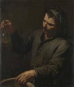 手に尿瓶を持っている男